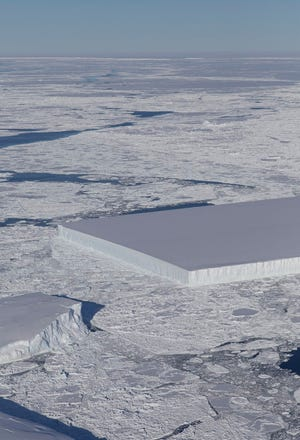 This image captured by NASA shows a tabular iceberg, which looks broad and flat.