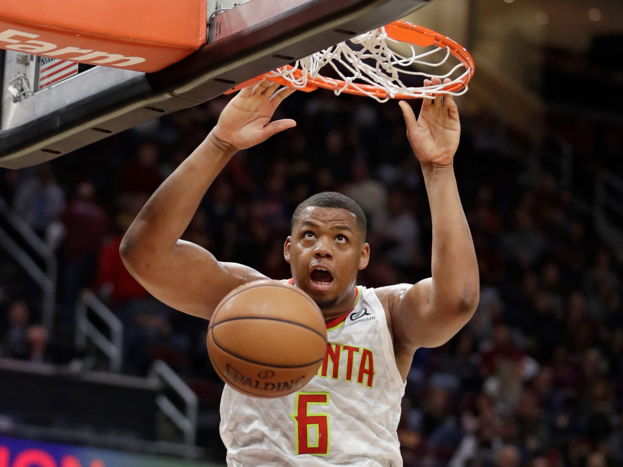 Oct. 21: An unguarded Omari Spellman slams down a dunk for the Hawks against the Cavaliers.
