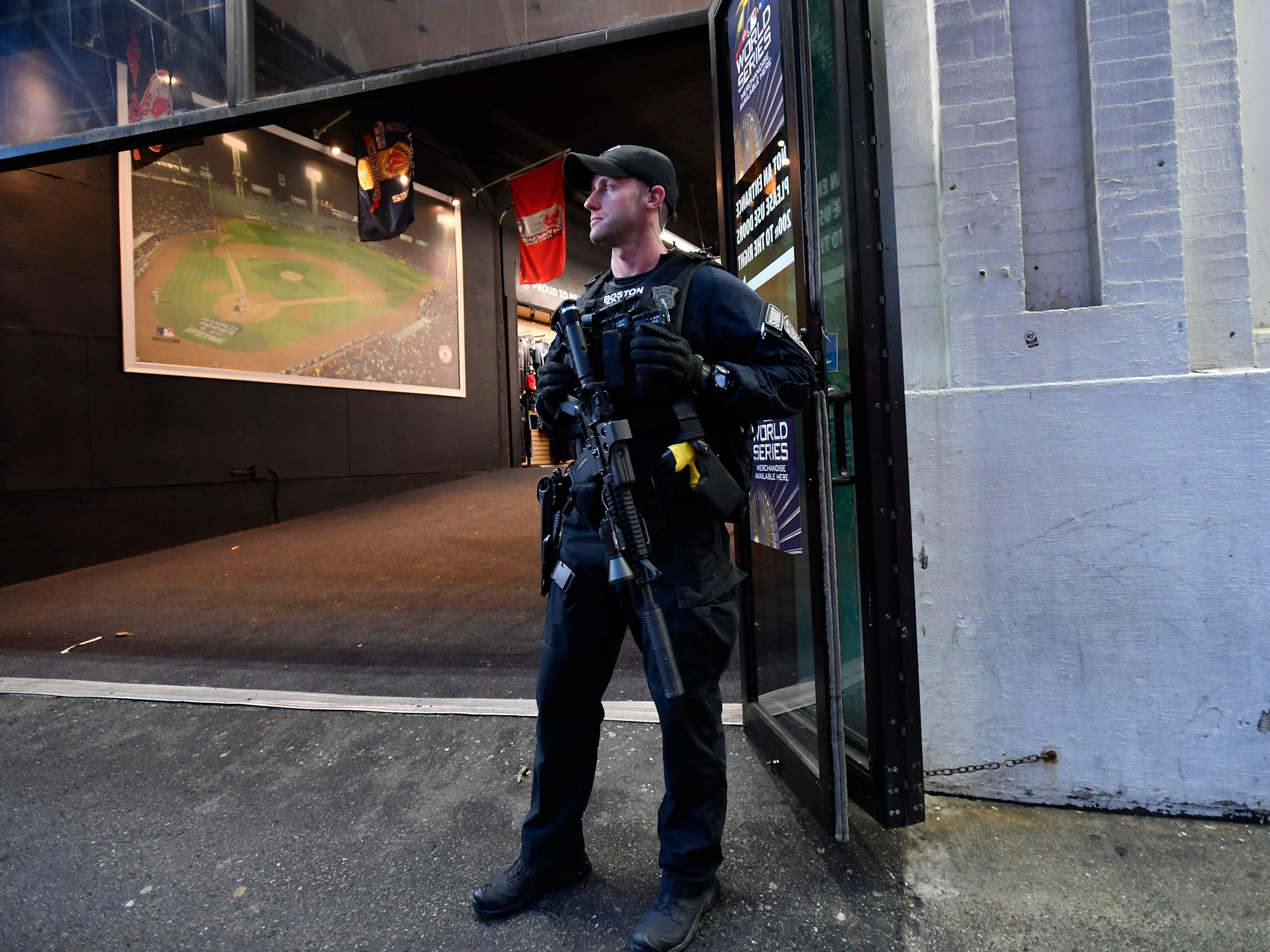 Game 1 at Fenway Park: Boston swat team member on patrol outside the stadium.