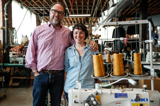 Detroit Denim founder Eric Yelsma, left, and partner and product manager Brenna Lane at the Detroit Denim Factory and Store in Detroit, Sunday, August 5, 2018.