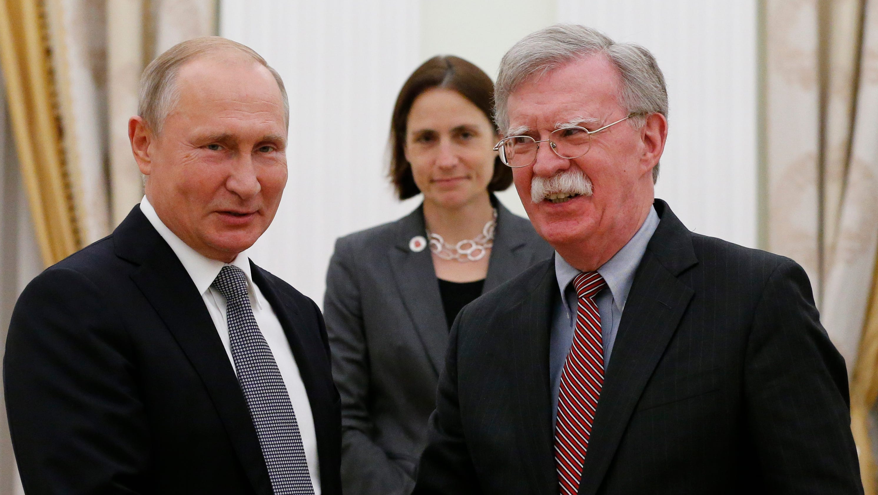Russian President Vladimir Putin, left, and U.S. National security adviser John Bolton shakes hands during their meeting in the Kremlin in Moscow, Russia, Tuesday, Oct. 23, 2018. Putin poked fun at the official seal of the United States while hosting U.S. President Donald Trump's national security adviser Tuesday, saying he wondered if the American eagle had plucked all the olives from the branch in its talon.