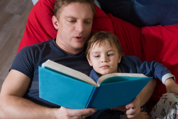 After a divorce, parents can help their children feel in control by keeping daily routines, like a bedtime story, consistent.