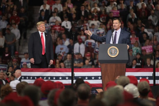 Republican candidate for governor of Kansas Kris Kobach speaks at a rally with President Donald Trump at the Kansas Expocenter on Oct. 6, 2018, in Topeka, Kansas.