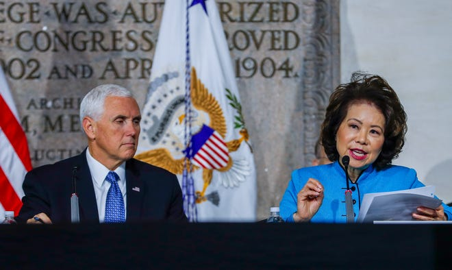 epa07113869 US Vice President Mike Pence (L) listens to US Transportation Secretary Elaine Chao (R) during a meeting of the National Space Council at the National War College at Fort McNair in Washington, DC, USA, 23 October 2018. US President Donald Trump has proposed the creation of the US Space Force, a sixth branch of the US Armed Forces.  EPA-EFE/ERIK S. LESSER ORG XMIT: ELX02