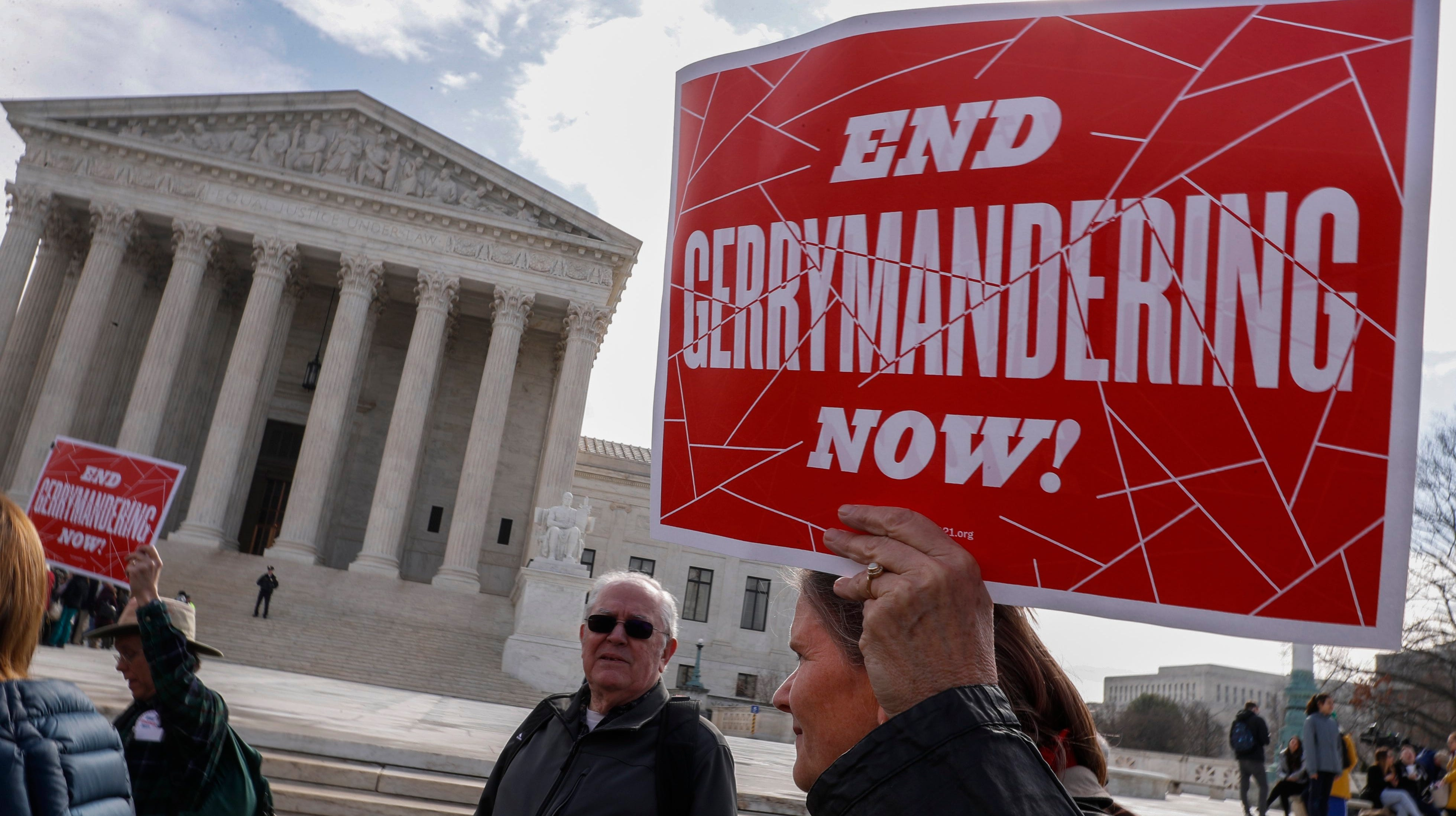 Protesters rally outside the Supreme Court as justices hear arguments in a Maryland gerrymandering case March 28.