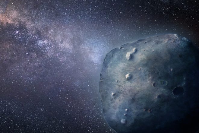 An artist's conception of Phaethon, an unusual blue asteroid.