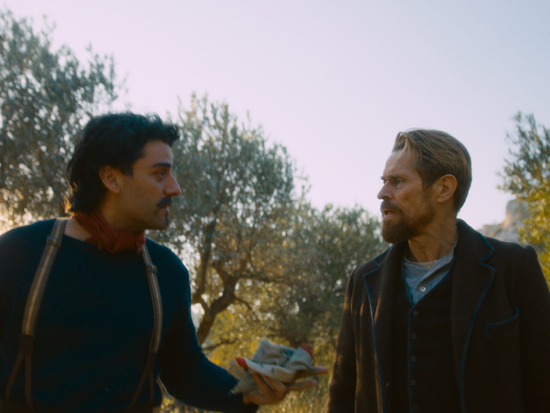 "Oscar Isaac (left) plays famed artist Paul Gauguin and Willem Dafoe is Vincent Van Gogh in the period drama ""At Eternity's Gate."""