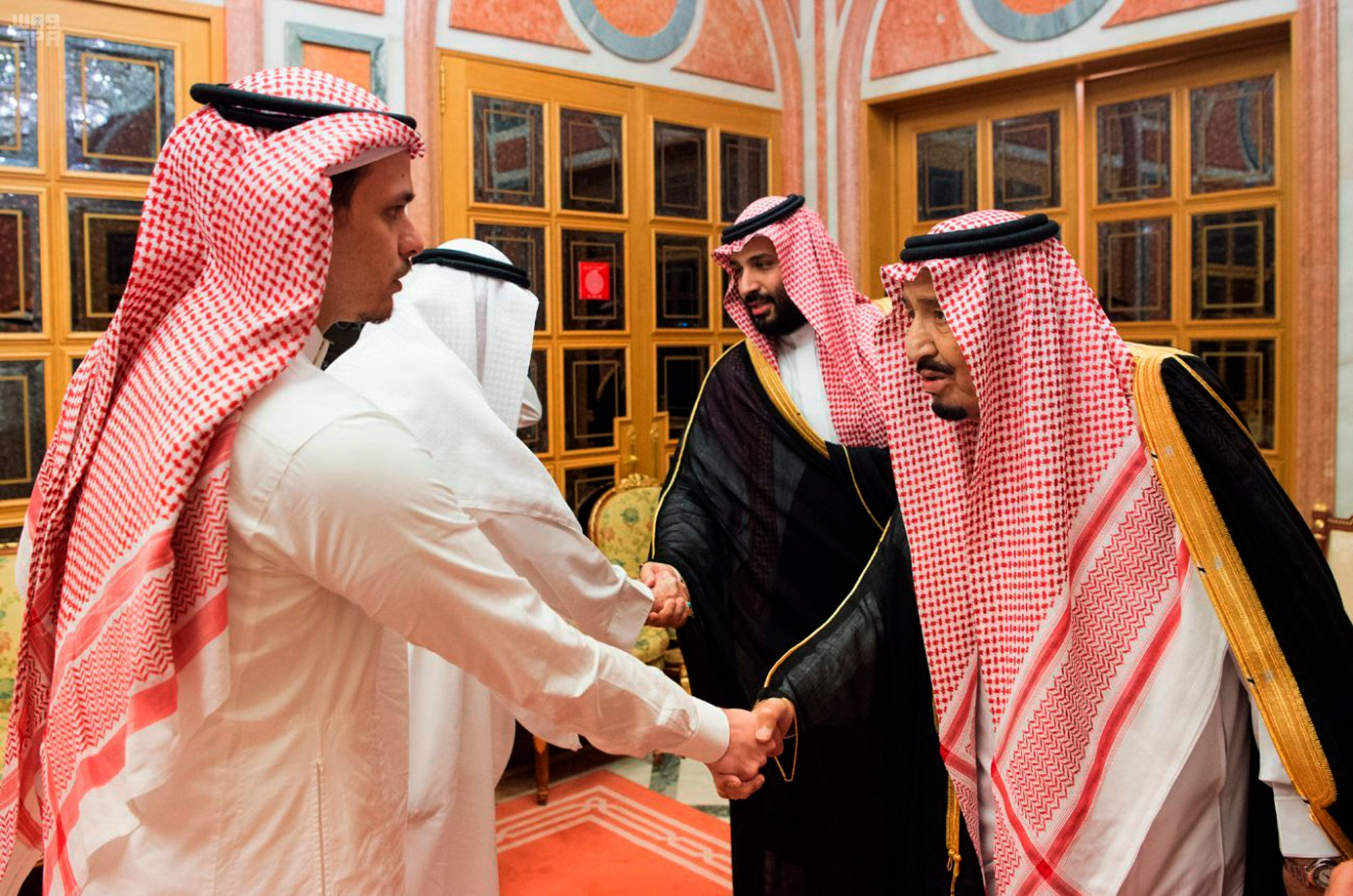 """Saudi King Salman, right, and Crown Prince Mohammed bin Salman, second right, receive Sahel, a family member, and Salah, a son, of Jamal Khashoggi, in Riyadh, Saudi Arabia, Tuesday, Oct. 23, 2018. Saudi Arabia, which for weeks maintained that Jamal Khashoggi had left the Istanbul consulate, on Saturday acknowledged he was killed there in a """"fistfight."""""""