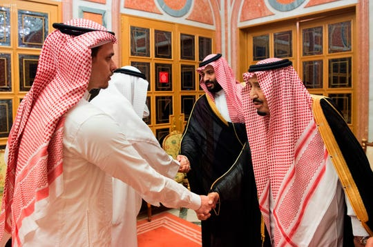 "Saudi King Salman, right, and Crown Prince Mohammed bin Salman, second right, receive Sahel, a family member, and Salah, a son, of Jamal Khashoggi, in Riyadh, Saudi Arabia, Tuesday, Oct. 23, 2018. Saudi Arabia, which for weeks maintained that Jamal Khashoggi had left the Istanbul consulate, on Saturday acknowledged he was killed there in a ""fistfight."""