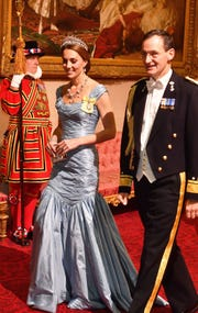 Duchess Kate of Cambridge walks with Rear Admiral Ludger Brummelaar during a state banquet at Buckingham Palace on Oct. 23, 2018, honoring King Willem-Alexander and Queen Maxima of the Netherlands.