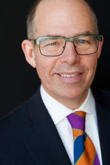 Designer Michael Bierut poses for a studio photo. Bierut is a designer for Pentagram.