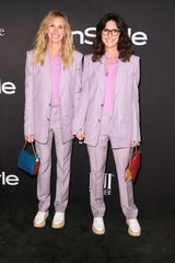 Twinning Julia Roberts and her stylist, Elizabeth Stewart, wore purple Givenchy suits for the InStyle Awards.