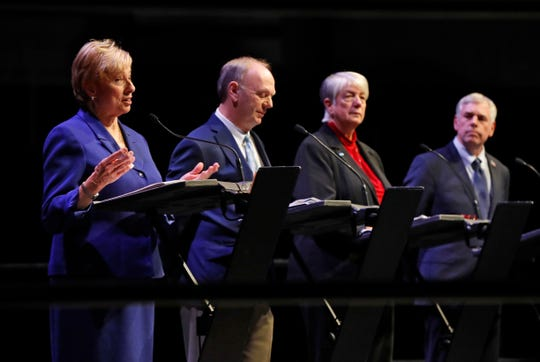 Maine gubernatorial candidate Democrat Janet Mills, far left, speaks during a debate with fellow candidates Independent Alan Caron, second from left, Independent Teresea Hayes, and Republican Shawn Moody on Oct. 17, 2018, at the Augusta Civic Center in Augusta, Maine.