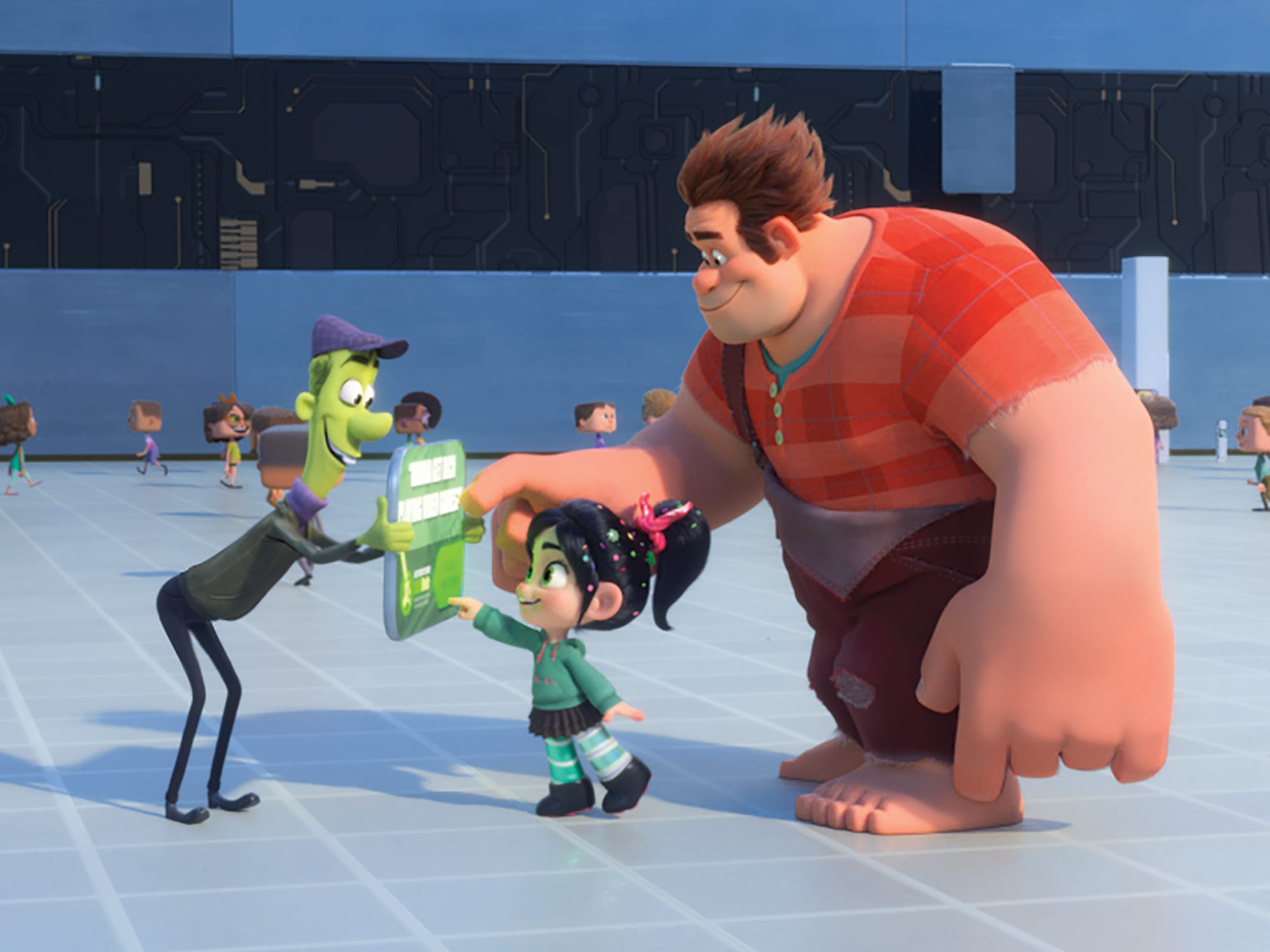 "Vanellope (voiced by Sarah Silverman, center) and Ralph (John C. Reilly) learn about click bait in the ""Wreck-It Ralph"" sequel ""Ralph Breaks the Internet."""