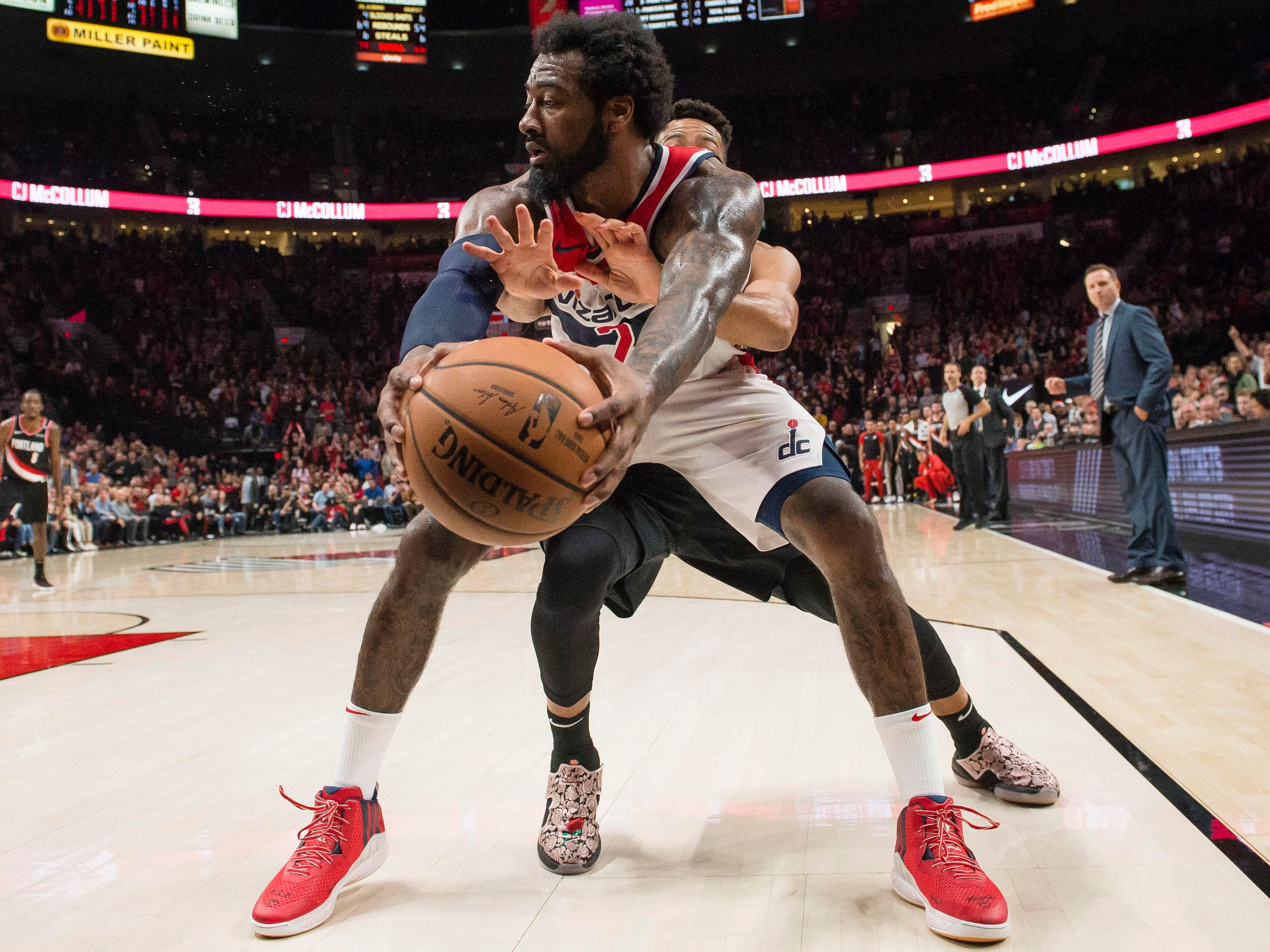 Oct. 22: Wizards guard John Wall, front, keeps the ball away from Trail Blazers defender C.J. McCollum during the second half in Portland.