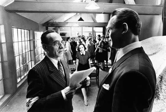 "Ben Kingsley (left) plays Itzhak Stern and Liam Neeson is Oskar Schindler in Steven Spielberg's ""Schindler's List."""