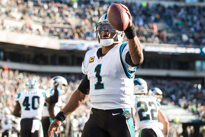Carolina Panthers quarterback Cam Newton (1) celebrates his touchdown pass to tight end Greg Olsen (not pictured) during the fourth quarter against the Philadelphia Eagles at Lincoln Financial Field.