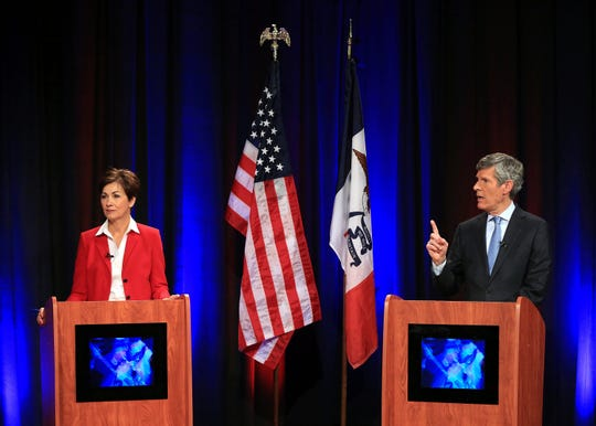 Iowa Gov. Kim Reynolds and democratic candidate Fred Hubbell debate Oct. 21, 2018, in the KWQC-TV studios in Davenport, Iowa.