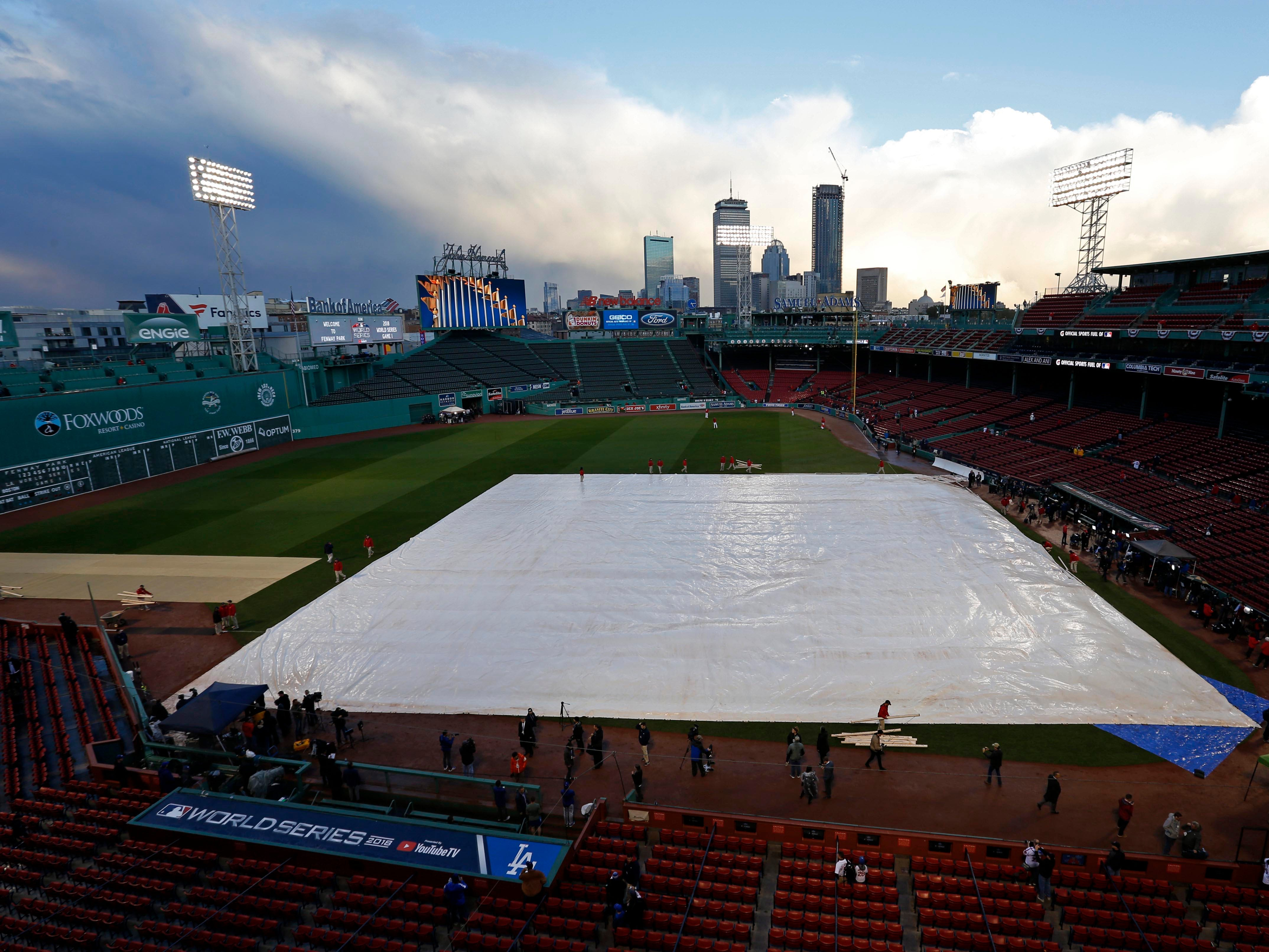 Game 1 at Fenway Park: The tarp sits on the field hours before first pitch.