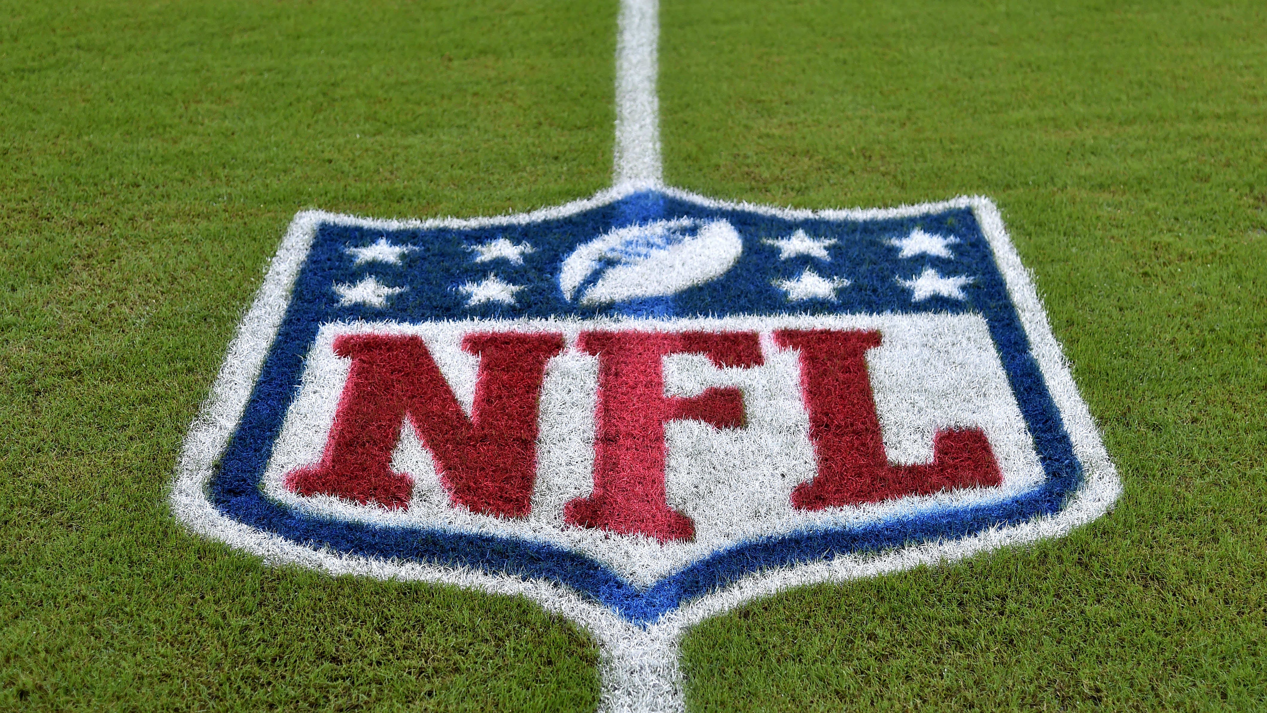 The NFL logo is seen on the field before a game.