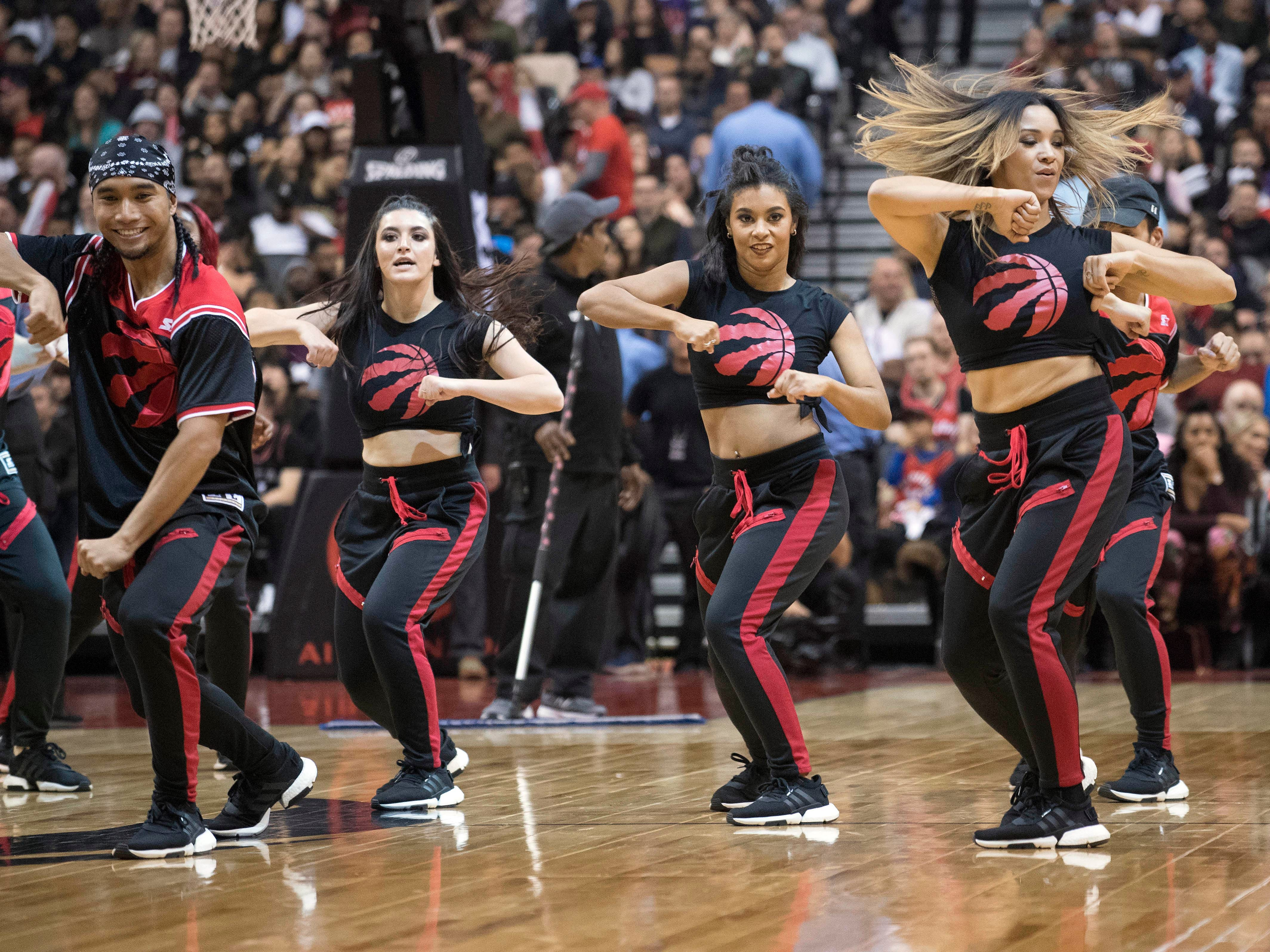 Oct 22: The Toronto Raptors Dance Pak performs during the fourth quarter against the Charlotte Hornets at Scotiabank Arena.