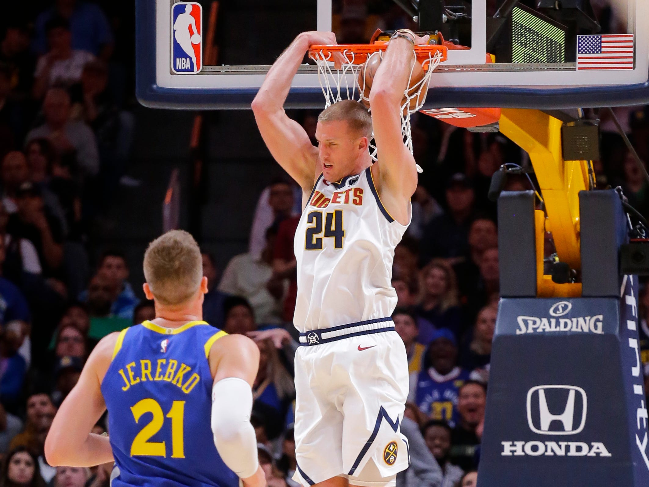 Oct. 21: Nuggets forward Mason Plumlee throws in a reverse two-handed jam against the Warriors.