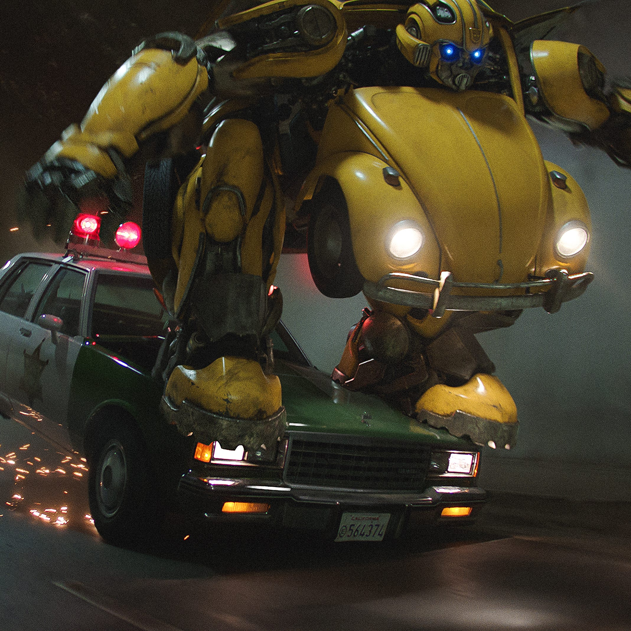 "Bumblebee takes out a police car while in mid-transformation in the 1980s-set ""Transformers"" spinoff ""Bumblebee."""