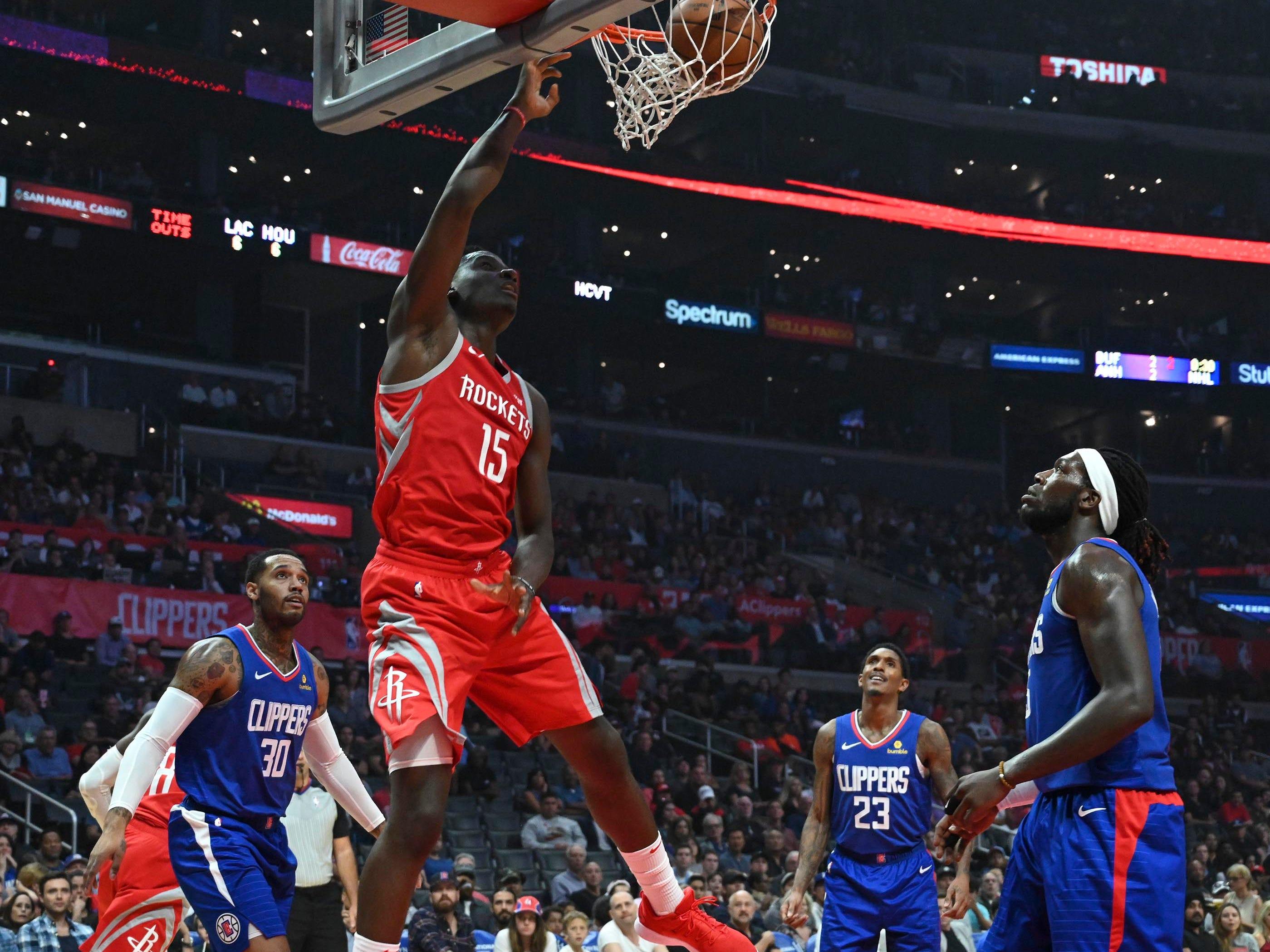 Oct 21: Rockets center Clint Capela rises for a right-handed slam against the Clippers.
