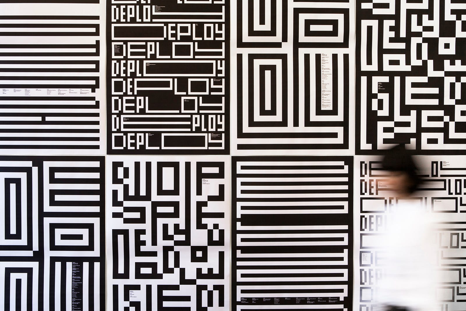 "Posters from the MIT Media Lab were designed by Michael Bierut and his team at Pentagram as part of a bigger branding project for the organization. The design includes the word ""deploy"" in it's iconic display. Parts of the design carry through to other things like corporate logos and business cards for the media lab."
