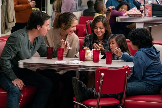 "A married couple (Mark Wahlberg, far left, and Rose Byrne) adopt a a trio of foster siblings (Isabela Moner, Julianna Gamiz and Gustavo Quiroz) in the comedy ""Instant Family."""