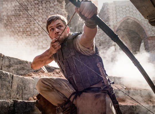 "Taron Egerton stars as a young Crusader who takes up bow and arrow against corrupt Englishmen in the action-adventure ""Robin Hood."""