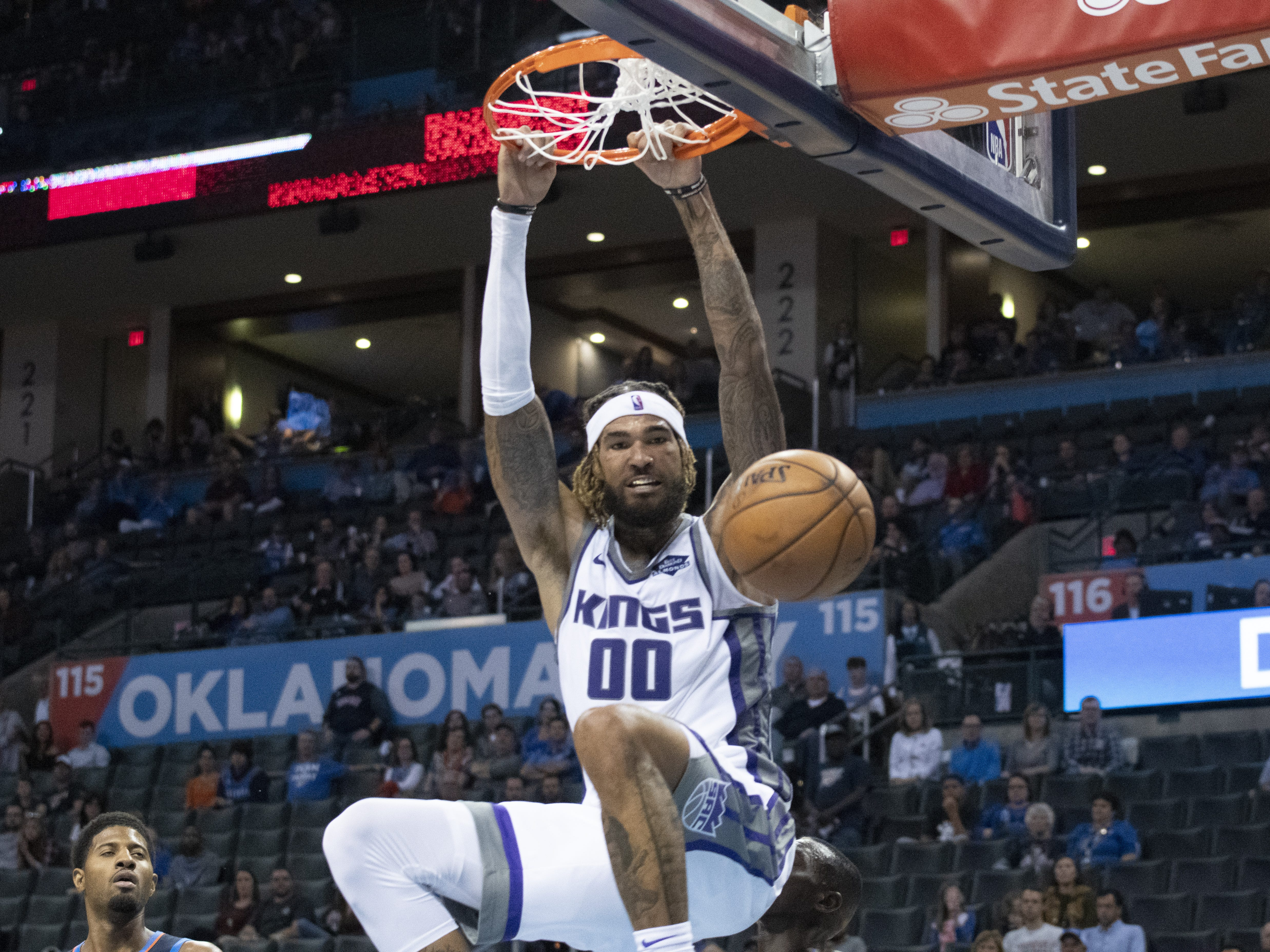 Oct. 21: The Kings' Willie Cauley-Stein grabs the rim after throwing one down on the Thunder.