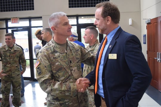 Lt. Col. Kenneth Baillie (left), recruiting commander for the Louisiana National Guard, talks with Fred Holt, vice president for enrollment at Louisiana College, after a press conference announcing that LC will match scholarships available to members of the U.S. military and the reserves. Holt is a former U.S. Army sergeant first class According to www.military.com, U.S. Army Reserves get 100 percent tuition assistance up to $250 per semester hour; or $166 per quarter hour, not to exceed $4,500 annually. For officers pursuing a bachelor's degree, USAR offers 75 percent, up t $25 per semester hour, $166 per quarter hour, and $4500 per fiscal year. For more information about the program, visit www.military.com
