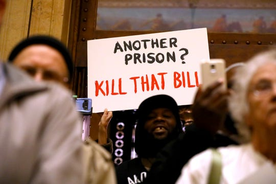 A group of citizens gathers at the Wisconsin State Capitol on March 13, 2018 to protest the inclusion of a $350 million prison on a bill that would have made unrelated changes to Department of Corrections' policy on probation and parole. The prison measure — added after the public hearing — would have resulted in the first new prison in Wisconsin in 17 years. The Senate declined to take up the bill.