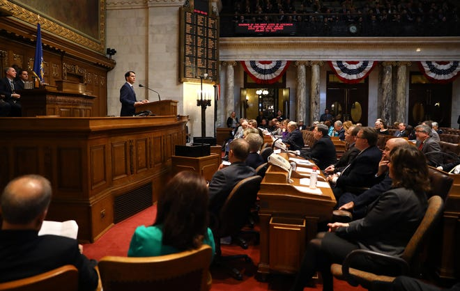 Gov. Scott Walker speaks at the State of the State address in Madison, Wis., held at the State Capitol building, on Jan. 10, 2017. A comparison of omnibus budget motions showed both parties have used the controversial mechanism to anonymously tuck items into the state budget, but the size and impact of the items included has ballooned during Walker's tenure.