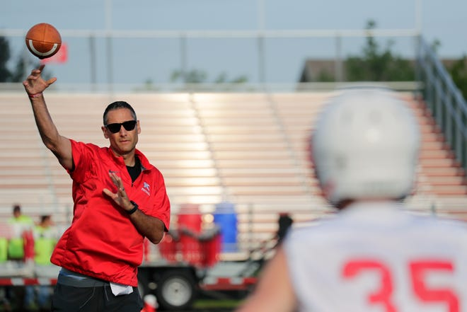 Kimberly coach Steve Jones throws a pass during football practice on Aug. 1 at Papermaker Stadium in Kimberly.