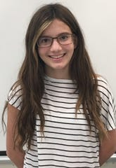Mya Burgos of Memorial Middle School won first place in the Student Voices essay contest for grades 7-8.