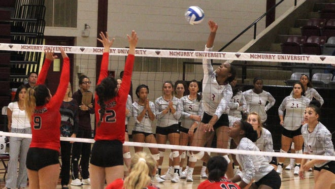Jasmine Jones goes up to an attack during a match earlier this season. On Tuesday she led all players in kills with 11 as McMurry won in straight sets over Arlington Baptist.