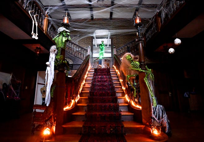 The main staircase of the Swenson House Wednesday decorated for Halloween.