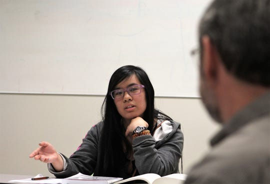 Celine Nguyen offers her point of view during an evening class led by Dr. Mark Waters.