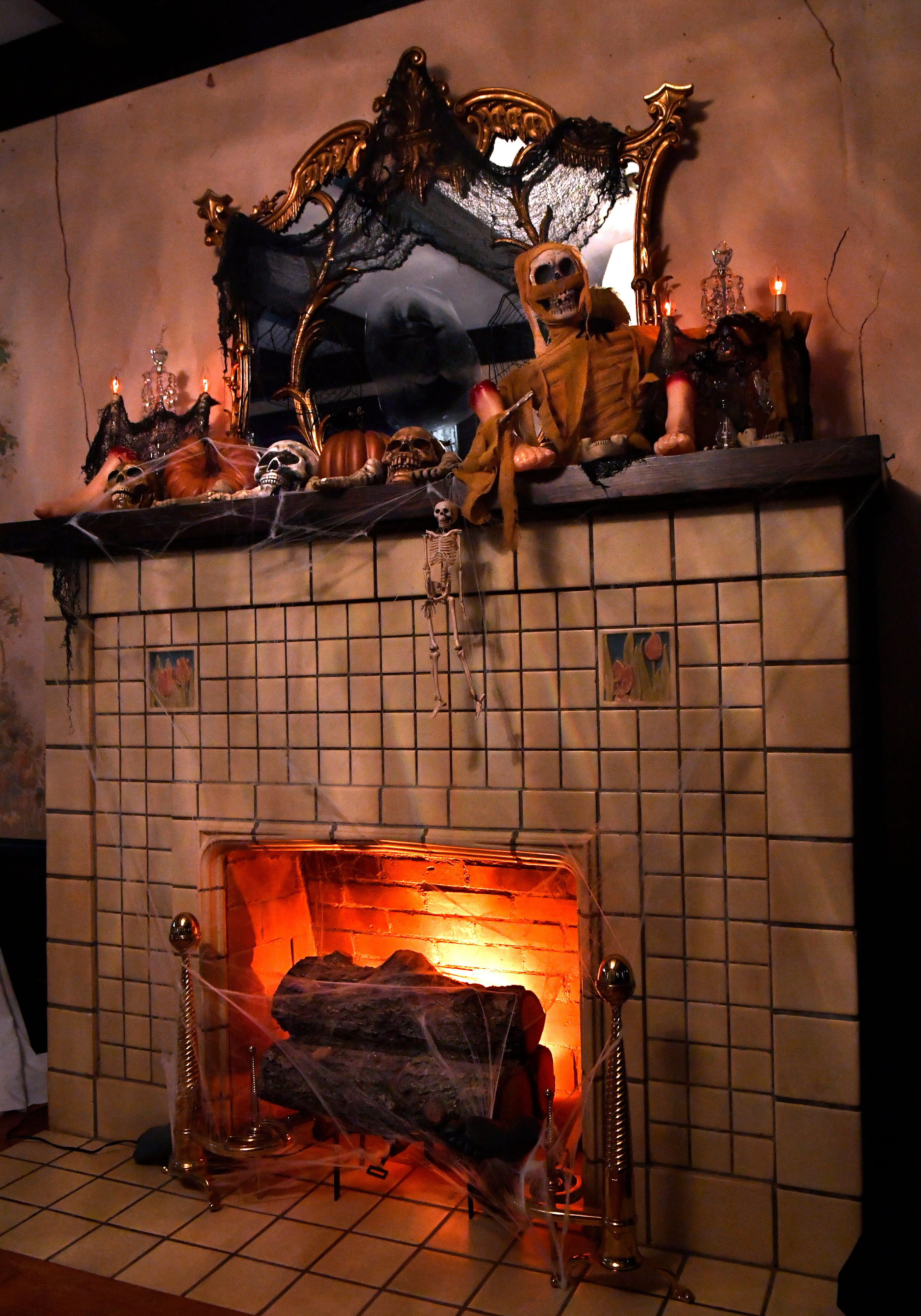 A fireplace in the Swenson House is lit with spooky lights.