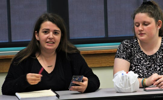 Rachel Parr, left, gives her views during a recent evening class at McMurry University led by Dr. Mark Waters. Mariah Fusco listens. Many in the class are to attend the Toronto conference.