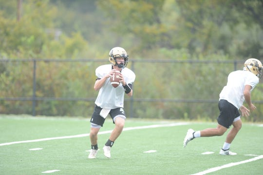 Matt Ezzell drops back to pass during a practice. The sophomore led two touchdown drives last week at Haltom after coming off the sidelines.