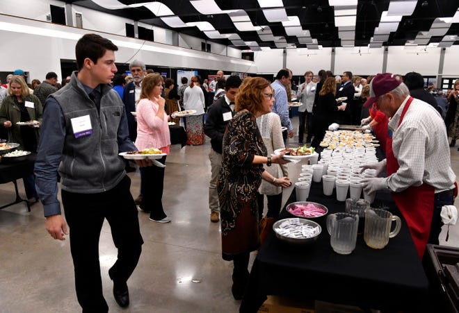 Attendees line up for lunch at the Texas Midwest Community Network's 25th annual meeting Wednesday at the Abilene Convention Center.