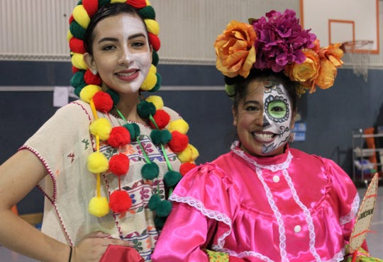 Julissa Ruiz, left, in another costume, and Joyce Martinez Sledge show the color and creativity that is essential to a performance by Ballet Folklorico del Big Country. The local dance troupe practiced Tuesday for its performance Saturday with the Abilene Philharmonic Orchestra.