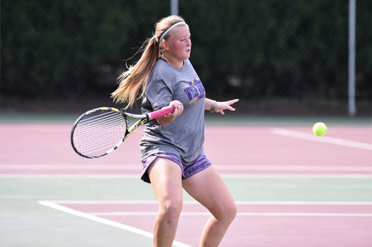 Wylie's Elle Schroeder hits a shot during the No. 2 girls singles match in the Region I-5A quarterfinals against Canyon Randall in Vernon on Tuesday, Oct. 23, 2018. The Bulldogs won 10-6 to advance to the region tournament.