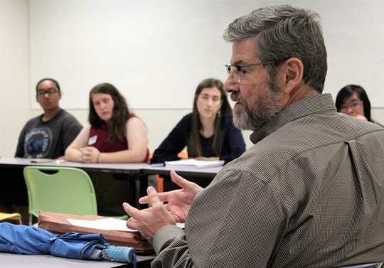 Dr. Mark Waters, director of International Education and professor of Religion and Servant Leadership at McMurry University, spoke during an evening class that includes several students who were to attend the Parliament of the World's Religions in Toronto. He presented a paper at the event.