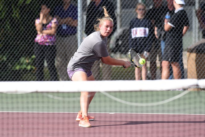 Wylie's Mandy Roberson lines up a backhand shot during the No. 6 girls singles match in the Region I-5A quarterfinals against Canyon Randall in Vernon on Tuesday, Oct. 23, 2018. The Bulldogs won 10-6 to advance to the region tournament.
