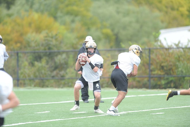 Matt Ezzell fakes a hand off as he looks to pass during a practice Wednesday Oct. 24, 2018. He will make his first start of his career against Weatherford.