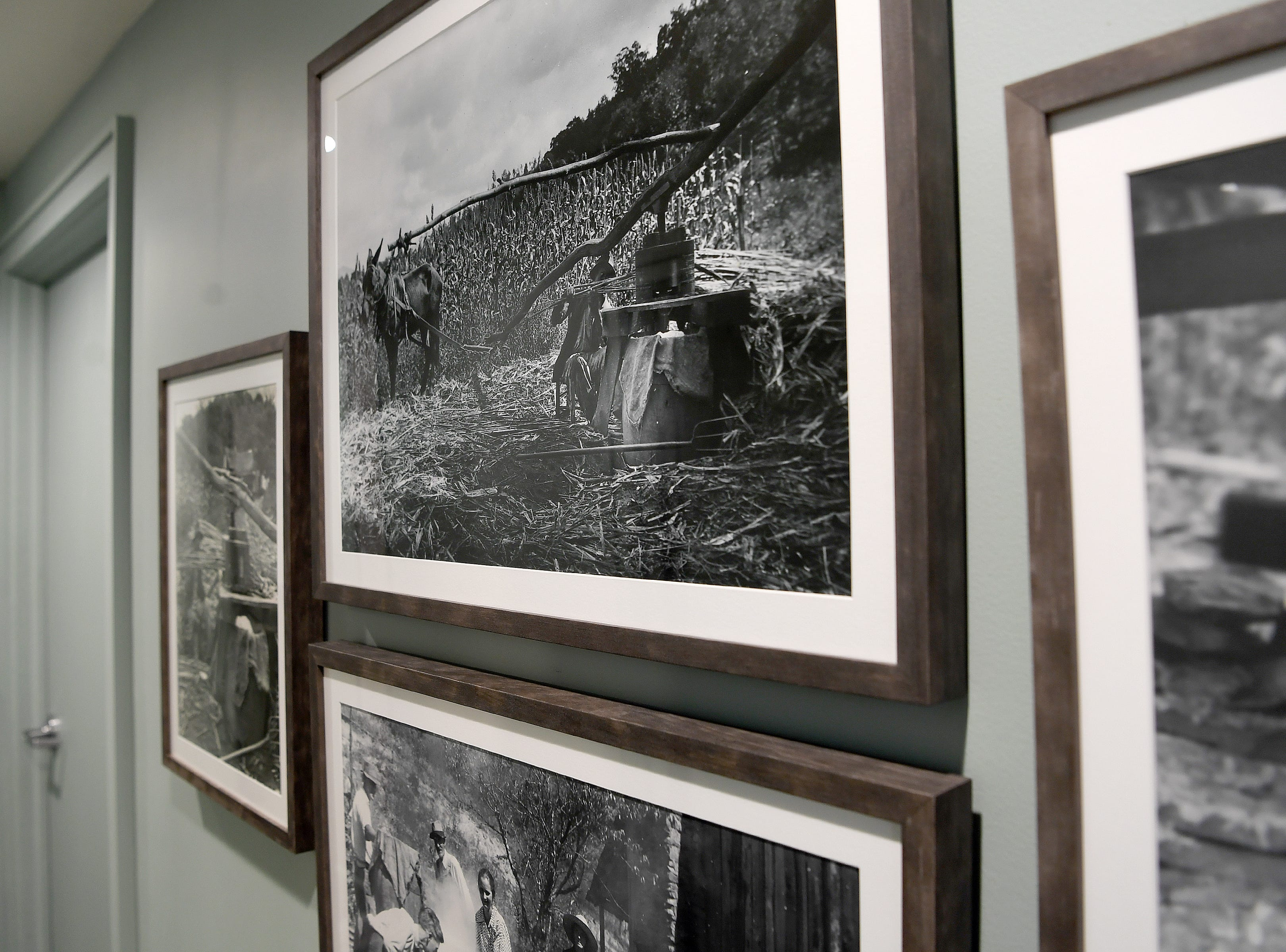 Photographs of sorghum being harvested in Black Mountain are on display at the soon-to-open Button & Co. Bagels on Lexington Avenue. Sorghum has been substituted in the New York-style recipe to give the bagels a Southern flair.